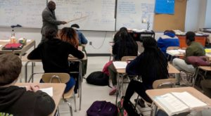 Lincoln Johnson teaches his 9th grade precalculus class at Hillhouse High School in New Haven