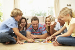 family plays board games